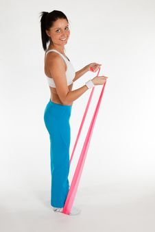 Free Woman Exercising With Rubber Ribbon Stock Photo - 18657130
