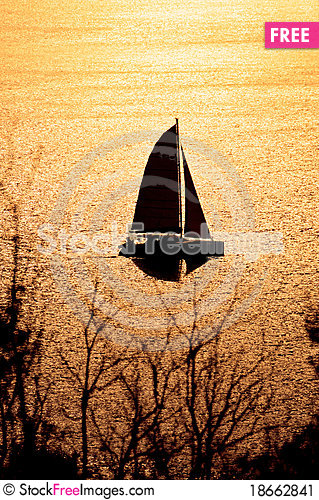 Catamaran on sunset Stock Photo