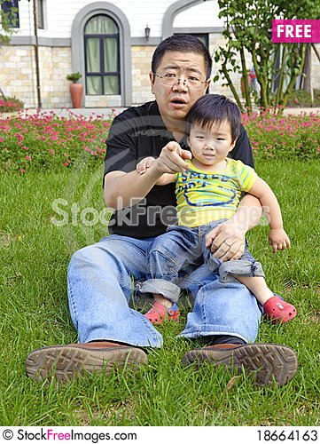 Happy baby with his father Stock Photo