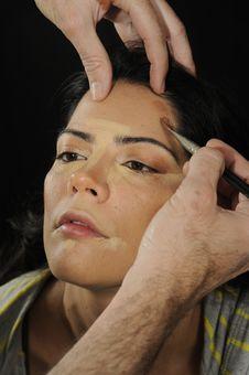 Free Hands Applying Make Up On Hispanic Girl Royalty Free Stock Photo - 18660295