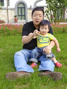 Happy Baby With His Father Stock Photos