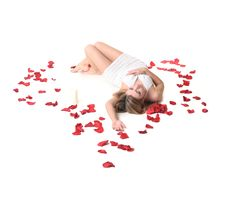 Free A Girl Lieing Among Rose Petals Royalty Free Stock Image - 18669506