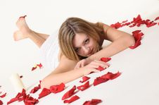 Free A Girl Lieing Among Rose Petals Stock Images - 18669524