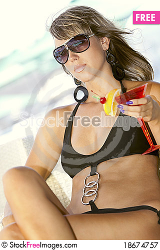 Woman enjoying with a glass of martini Stock Photo