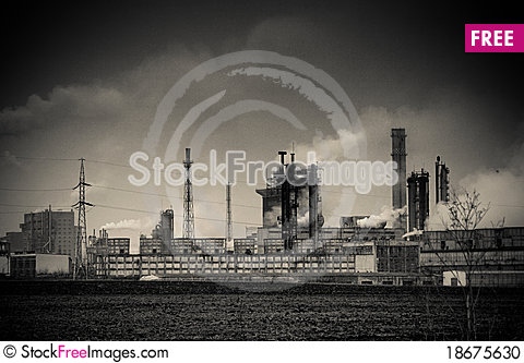 Smoke coming out of old factory chimney Stock Photo