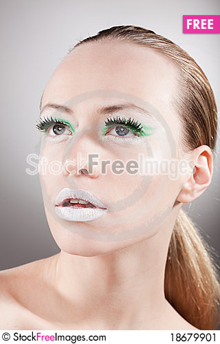 Beautiful calm woman portrait whith green make-up Stock Photo