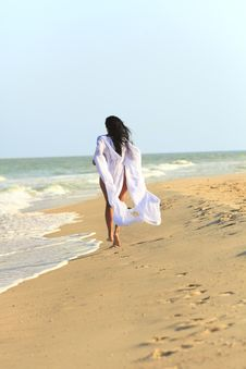 Free The Girl In White Coat At The Beach Stock Photo - 18674690
