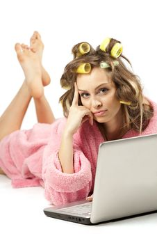Free Girl In Pink Dressing Gown Lying With Laptop Stock Images - 18674694