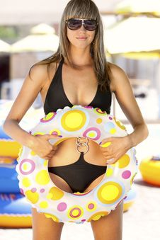 Model With Multicolored Inflatable Ring Royalty Free Stock Photography