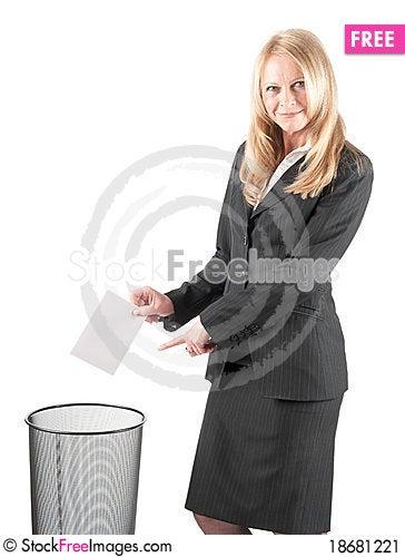 Woman is littering a letter in wastebasket Stock Photo