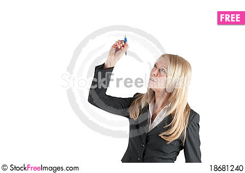 Middle aged woman writes with a pen Stock Photo