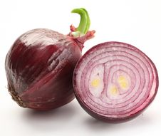 Bulbs Of Red Onion With Green Leaves Stock Photography