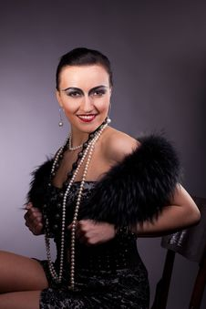 Proud Woman Smile In Fur Boa With Pearl Beads Royalty Free Stock Photography