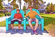 Free Two Brothers Are Sitting On A Art Deco Park Bench Royalty Free Stock Photography - 18680777