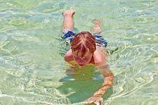 Boy Has Fun In The Clear  Ocean Stock Photos