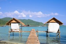 Free Wooden Beach Bungalows Over Water Royalty Free Stock Photos - 18682288