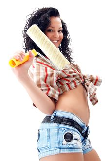 Sexy Craftswoman With A Roller Brush Royalty Free Stock Photos