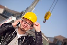 Young Construction Worker On Phone Front Of Crane Royalty Free Stock Photo
