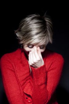 Free Woman In Red Pullover On Black Background Royalty Free Stock Photography - 18684527
