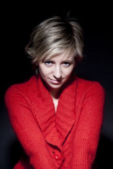 Free Woman In Red Pullover On Black Background Royalty Free Stock Photos - 18684598
