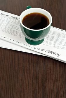 Free Cup Of Coffee On Newspaper Stock Photo - 18684750