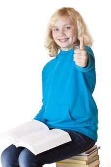 Free Happy Schoolgirl Sitting On Books Showing Thumb Royalty Free Stock Images - 18684819