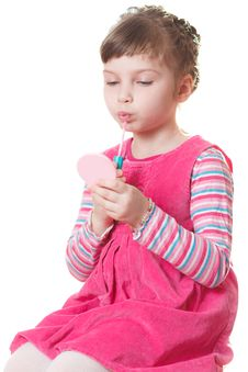 Little Girl With Lipstick Stock Images