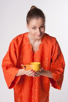 Free Girl In Orange Dress With A Cup Royalty Free Stock Images - 18686539