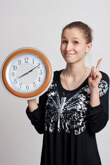 Free Beautiful Girl With A Big Clock In His Hands Royalty Free Stock Image - 18688096
