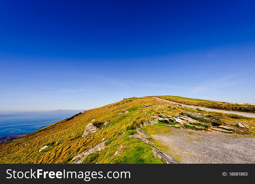Cliff by sea under blue sky , Ireland