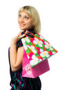 Free Beautiful Girl With Colorful Packages Looks Away. Royalty Free Stock Images - 18697769