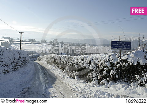 Snowy Road with sign Stock Photo