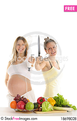 Happy woman with fruit, blender and a knife Stock Photo