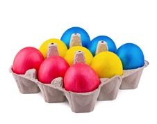 Bright Multi-colored Eggs In Cells Royalty Free Stock Photos