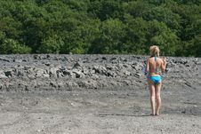 Free Girls Stands At Mud Vulcano. Stock Images - 18690984