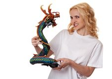 Free Beautiful Girl With A Wooden Dragon Stock Photography - 18694602