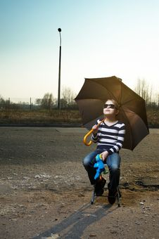 Outdoor Portrait Of A Little Girl With Umbrella Stock Image