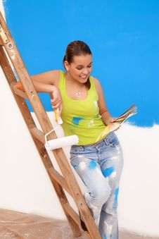 Free Woman Looking At Paint Samples Royalty Free Stock Images - 18698089