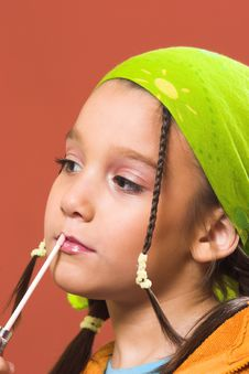 Free Child Applying Make-up Stock Image - 1870501