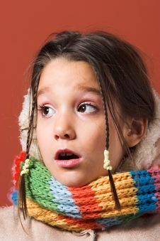Child With Coat And Scarf Stock Images