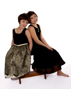 Dressy Sisters Back To Back Royalty Free Stock Photos