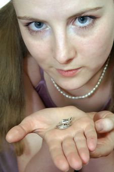 The Girl With Two Rings On A Palm Stock Photography