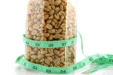 Peanuts In A Jar With Tape Measure 2 Royalty Free Stock Images