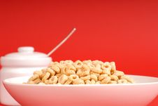 Free A Bowl Of Oat Cereal With Sugar Bowl On Red Background Royalty Free Stock Images - 1875159