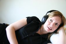 Side Shot Of Girl Smiling With Headphones And Music Royalty Free Stock Image