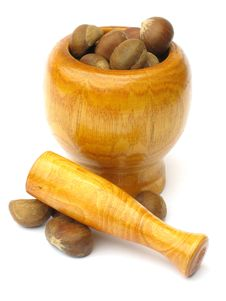 Free Wooden Mortar And Pestle With Chestnuts Royalty Free Stock Photos - 1878878