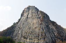 Free Gold Painting Of Buddha Statue On Cliff Stock Images - 18700014
