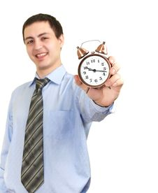 Free Businessman With An Alarm Clock In A Hand. Royalty Free Stock Image - 18701686