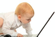 Free Baby Boy Using A Laptop Computer Royalty Free Stock Photos - 18702438