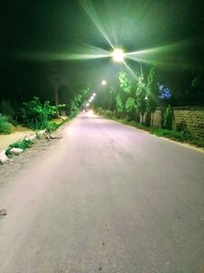 Night Empty Road With Street Lights Stock Photo